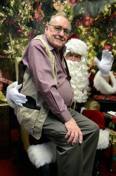 Jim Rounsavell with Santa
